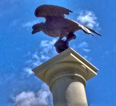 Statue of eagle on column at State House