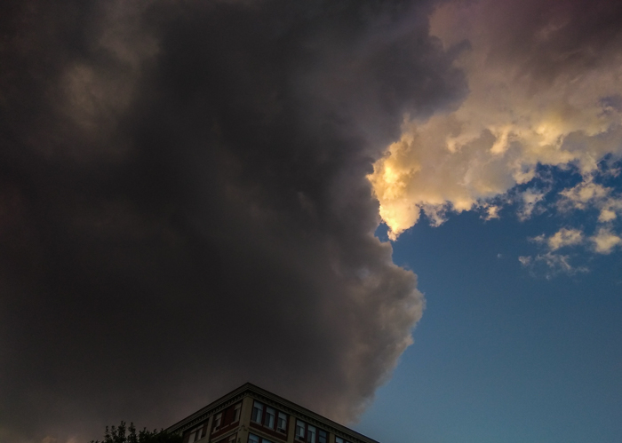 Storm clouds loom over apartment building