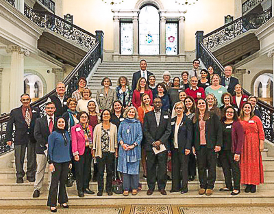 Bending the Arc participants gather on grand staircase at State House